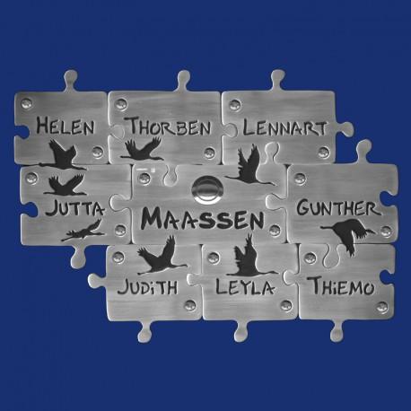 Puzzle-Klingelschild mit neun Puzzleteilen und Kranich-Motiven